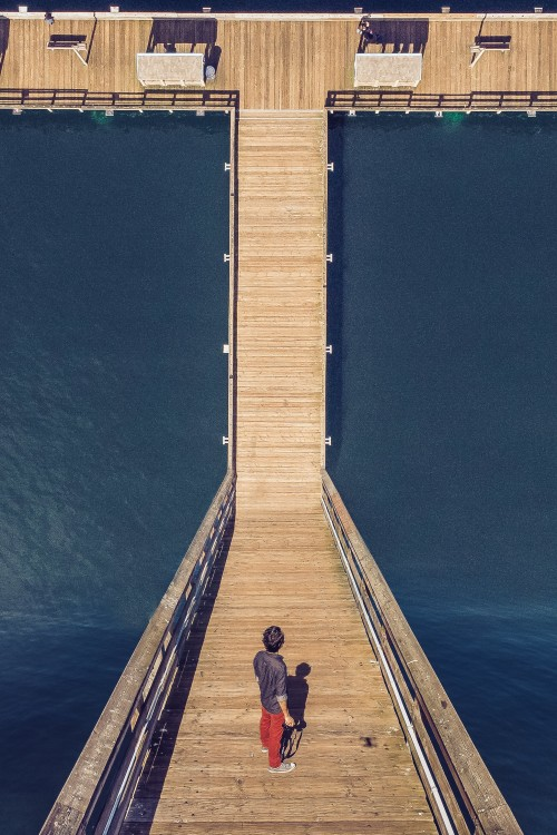 man-with-camera-stood-on-a-dock.jpg