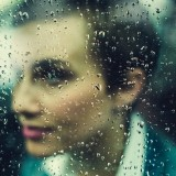 woman-behind-rainy-window